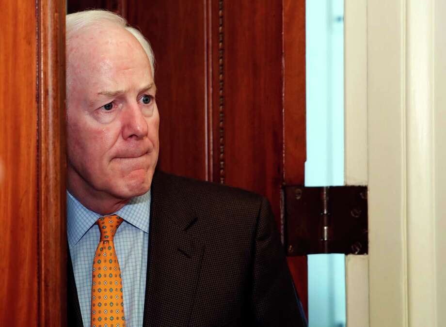 Senate Majority Whip Sen. John Cornyn, R-Texas, pauses to listen to a reporter's question as he enters his office on Capitol Hill, Friday, Jan. 19, 2018 in Washington. (AP Photo/Alex Brandon) Photo: Alex Brandon, Associated Press / Copyright 2018 The Associated Press. All rights reserved.