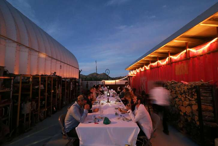 Diners tuck into a course just after sunset.