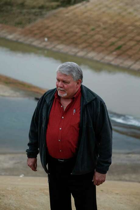 Former Assistant Fort Bend County Engineer Glen Crocker stands at the Barker Reservoir spillway Tuesday, Jan. 9, 2018 in Houston. Twenty-five years ago he discovered that new Cinco Ranch subdivisions could flood because the Barker reservoir footprint was bigger than the government-owned land. He reported his findings but was ultimately ignored. Photo: Michael Ciaglo, Houston Chronicle / Michael Ciaglo