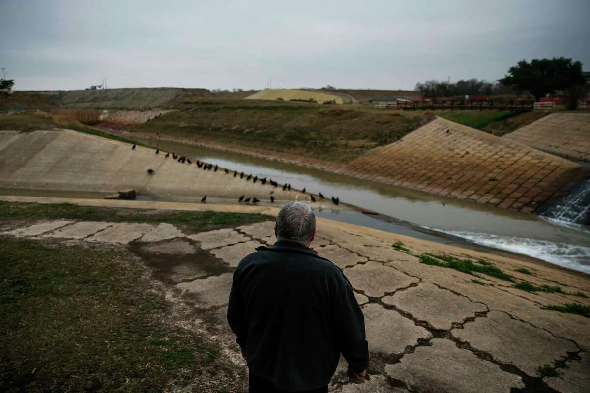 Former Assistant Fort Bend County Engineer Glen Crocker stands at the Barker Reservoir spillway Tuesday, Jan. 9, 2018 in Houston. Twenty-five years ago he discovered that new Cinco Ranch subdivisions could flood because the Barker reservoir footprint was bigger than the government-owned land. He reported his findings but was ultimately ignored.