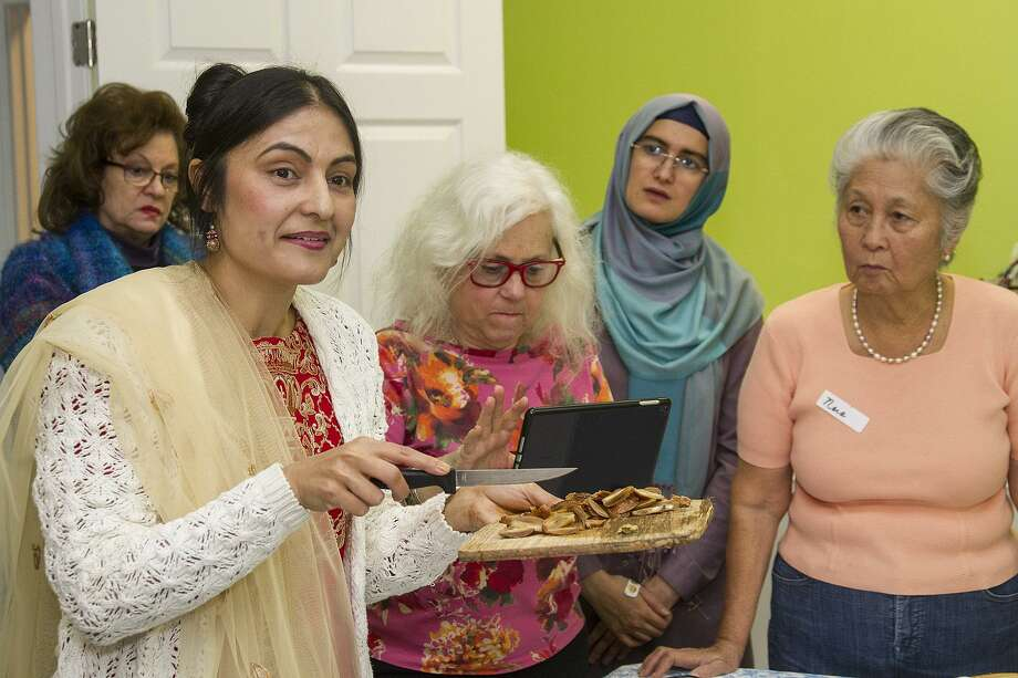 A physician in real life, Dr. Fozia Ali recently lead a Pakistani cooking class at Raindrop Turkish House. The class was part of a monthly cooking series of out-of-the-mainstream cuisines. Photo: Alma E. Hernandez /For The Express-News