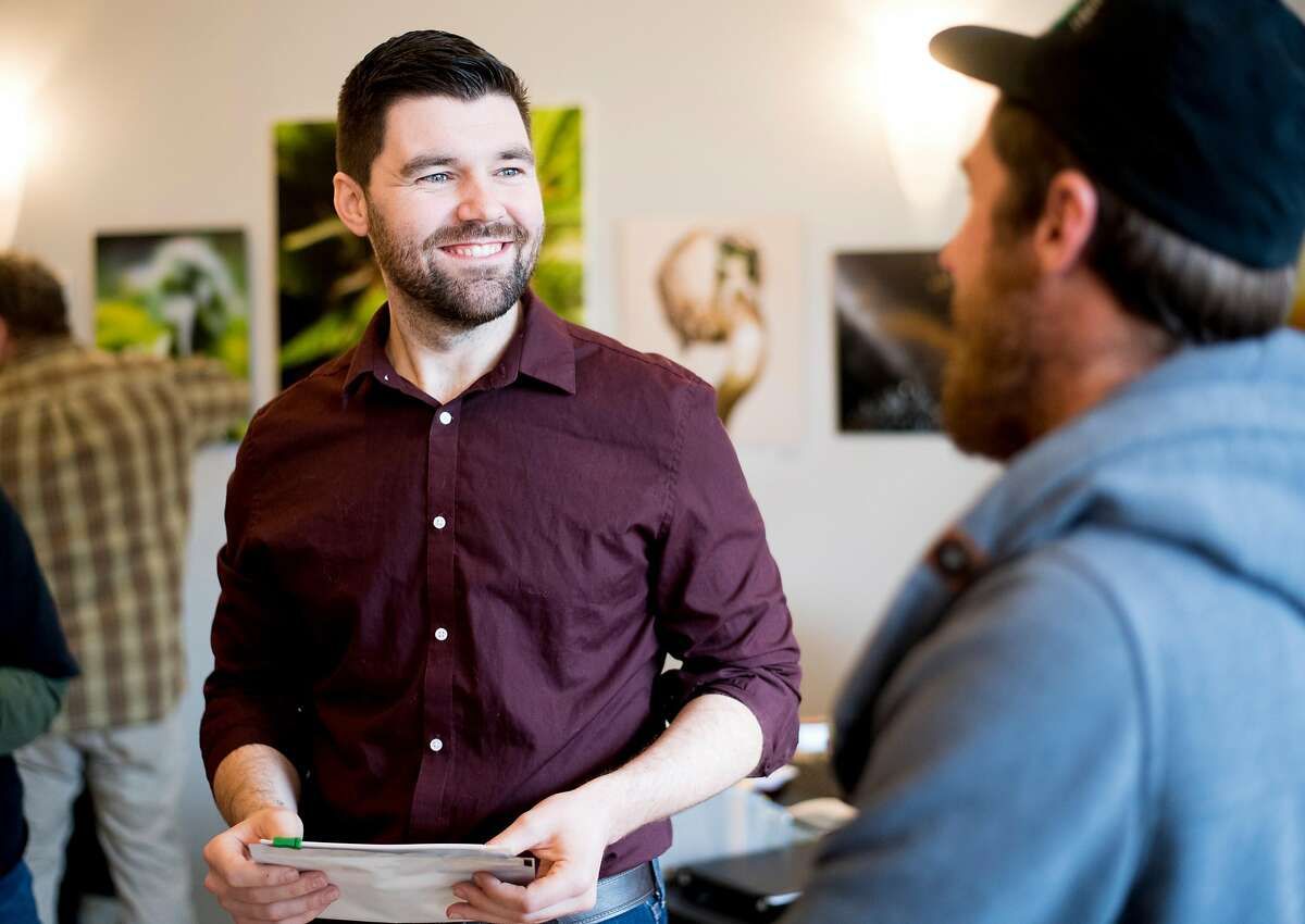 Ecological Cannabis Organization (ECO) company manager Ray Markland speaks with Matt Kurth, right, owner of Humboldt Cannabis Tours, at the Ecocann dispensary in Eureka, Calif., on Friday, Jan. 12, 2018.