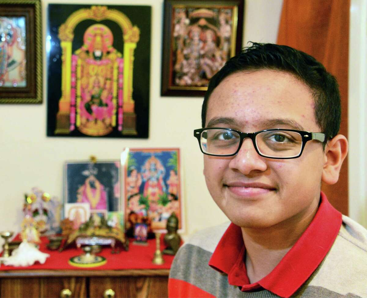 Shaker High School student Varun Mondaiyka, 15, at his home's Hindu shrine Thursday Jan. 18, 2018 in Colonie, NY. (John Carl D'Annibale/Times Union)