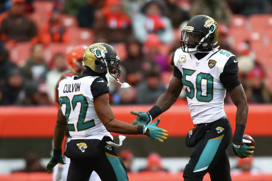 CLEVELAND, OH - NOVEMBER 19: Telvin Smith #50 of the Jacksonville Jaguars celebrates an interception with Aaron Colvin #22 of the Jacksonville Jaguars in the first quarter against the Cleveland Browns at FirstEnergy Stadium on November 19, 2017 in Cleveland, Ohio. (Photo by Gregory Shamus/Getty Images) ORG XMIT: 700070747 Photo: Gregory Shamus / 2017 Getty Images