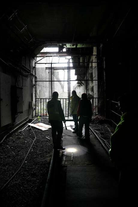 Gates at the old train entrance to Eureka Valley Station are locked. The station is used now as an access point for Muni Metro maintenance crews. Photo: Michael Macor, The Chronicle