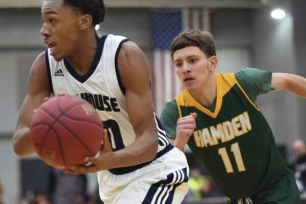 Hillhouse's J'Vaugn Hoover drives past Hamden's Victor Rosario, 59-56, Friday, Jan. 19, 2018, at Floyd Little Athletic Center in New Haven. Hillhouse won, 59-56.