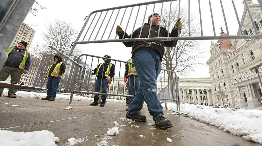New York State Office of General Services workers set up metal barriers for Saturday's Women's March on Friday, Jan. 19, 2018 in Albany, N.Y. Thousands are expected to attend. (Lori Van Buren/Times Union) Photo: Lori Van Buren