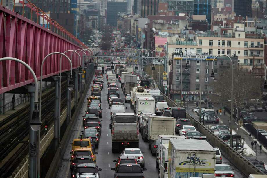 FILE - In this Jan. 11, 2018 file photo, traffic crosses the Williamsburg Bridge in New York from Brooklyn into Manhattan. Motorists would have to shell out $11.52 to drive into the busiest parts of Manhattan under a new proposal commissioned by Democratic Gov. Andrew Cuomo to ease traffic congestion and raise vital funds for mass transit. Trucks would pay even more, $25.34, while taxi cabs, Uber rides and for-hire vehicles would be charged between $2 and $5 per ride. (AP Photo/Mary Altaffer, File) Photo: Mary Altaffer / Copyright 2018 The Associated Press. All rights reserved.