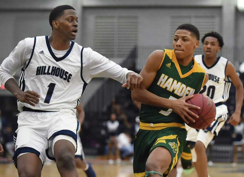 Hamden's Ronnie Ellis drives the paint as Hillhouse's Rayshawn Brewer defends, Friday, Jan. 19, 2018, at Floyd Little Athletic Center in New Haven. Hillhouse won, 59-56.