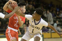 Midland High's Demorri Williams (1) goes after the ball against Odessa High's Isaac Hernandez (2) on Jan. 19, 2018, at Chaparral Center. James Durbin/Reporter-Telegram