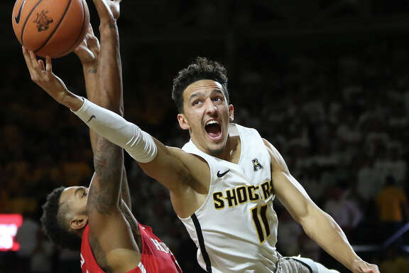 Wichita State's Landry Shamet takes a shot and is fouled against Houston during the second half at Koch Arena on Thursday, Jan. 4, 2018. The host Shockers won, 81-63. (Travis Heying/Wichita Eagle/TNS)