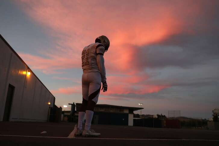 Cardinal Newman's Nikko Kitchen readies to play Rancho Cotate in the high school's  first football game since the Tubbs' Fire struck Santa Rosa. Photographed in Rohnert Park, Calif., on Monday, October 23, 2017.