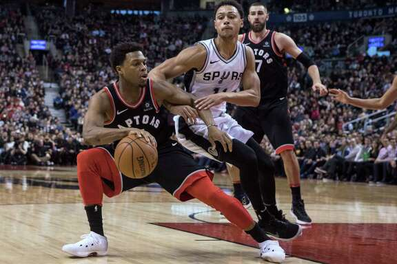 Toronto Raptors guard Kyle Lowry (7) peels away from San Antonio Spurs guard Bryn Forbes (11) during the second half of an NBA basketball game Friday, Jan. 19, 2018, in Toronto. (Chris Young/The Canadian Press via AP)
