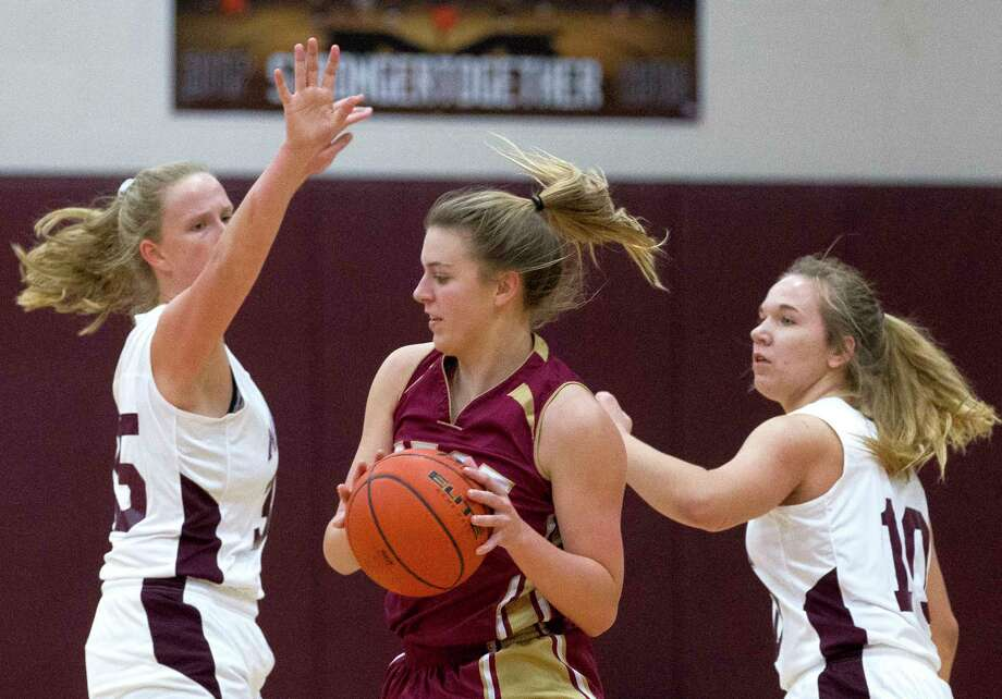 Magnolia West guard Hannah Eggleston (30) looks to pass under pressure from Magnolia center Kendall Bullard (35) and guard Lexi Bearden (10) during the first quarter of a Distric 20-5A high school girls basketball game at Magnolia High School, Friday, Dec. 22, 2017, in Magnolia. Photo: Jason Fochtman, Staff Photographer / © 2017 Houston Chronicle