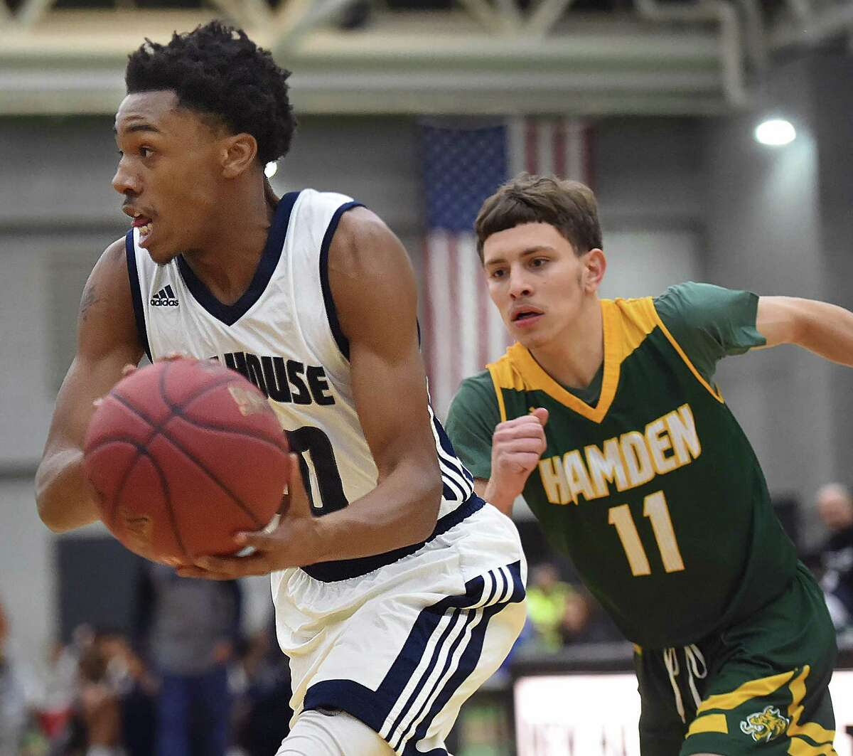 Hillhouse's J'Vaugn Hoover drives past Hamden's Victor Rosario Friday at the Floyd Little Athletic Center in New Haven. Hillhouse won 59-56.