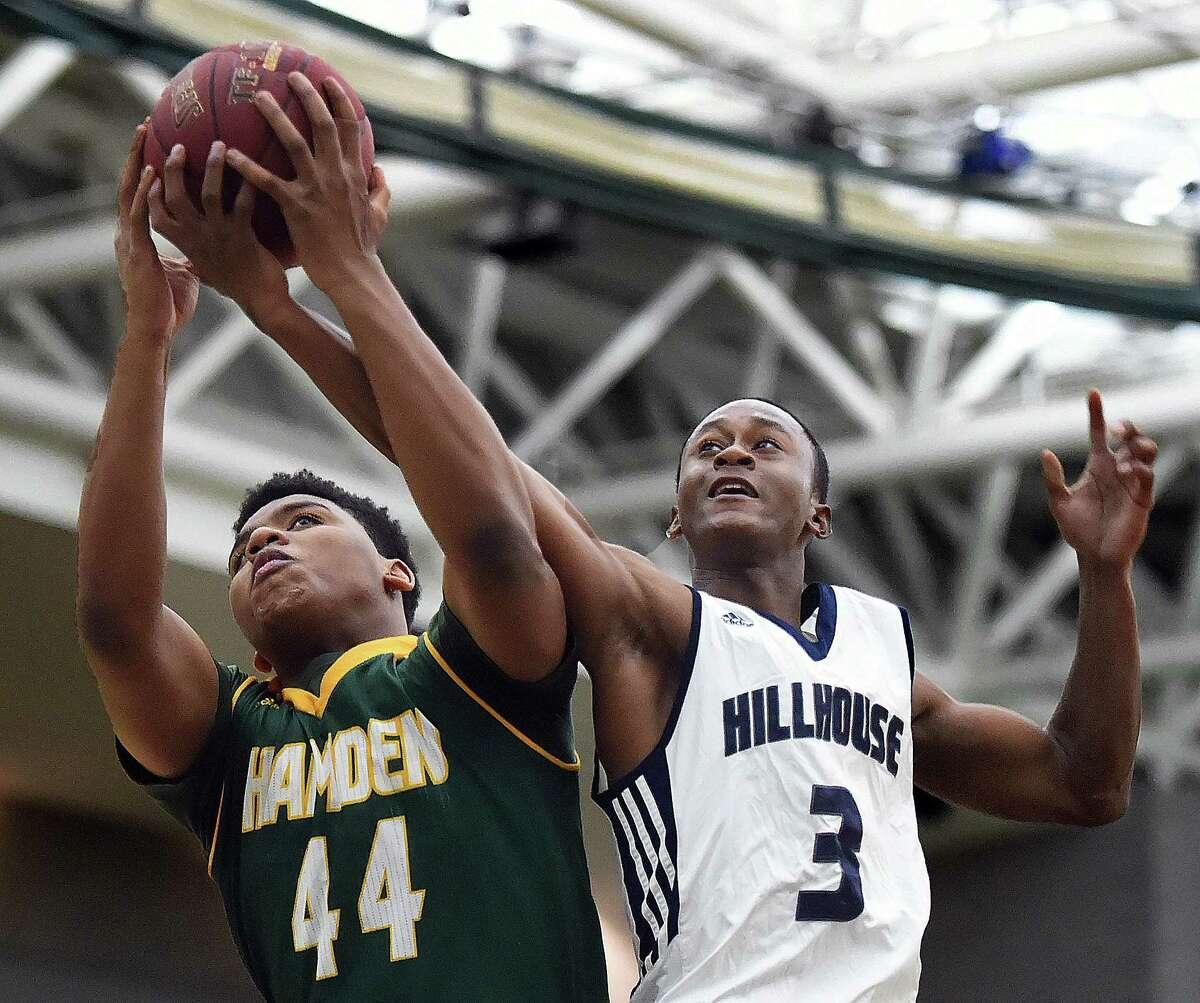 Hillhouse's Devon Warren battles Hamden's Justice Washington for a rebound, Friday at the Floyd Little Athletic Center in New Haven. Hillhouse won 59-56.