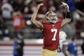 Colin Kaepernick (7) reacts after his 90-yard touchdown run during the second half as the 49ers played the San Diego Chargers at Levi's Stadium in Santa Clara, Calif., on Saturday, December 20, 2014.