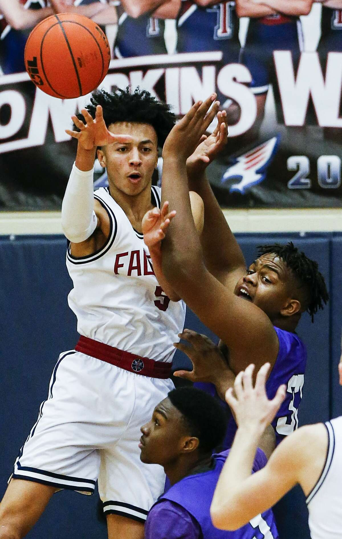 Tompkins' Emmanuel Holt (5) passes the ball as he is defended by Morton Ranch's Eddie Lampkin (32) during a 19-6A high school basketball game at Tompkins High School on Friday, Jan. 19, 2018, in Katy. ( Brett Coomer / Houston Chronicle )
