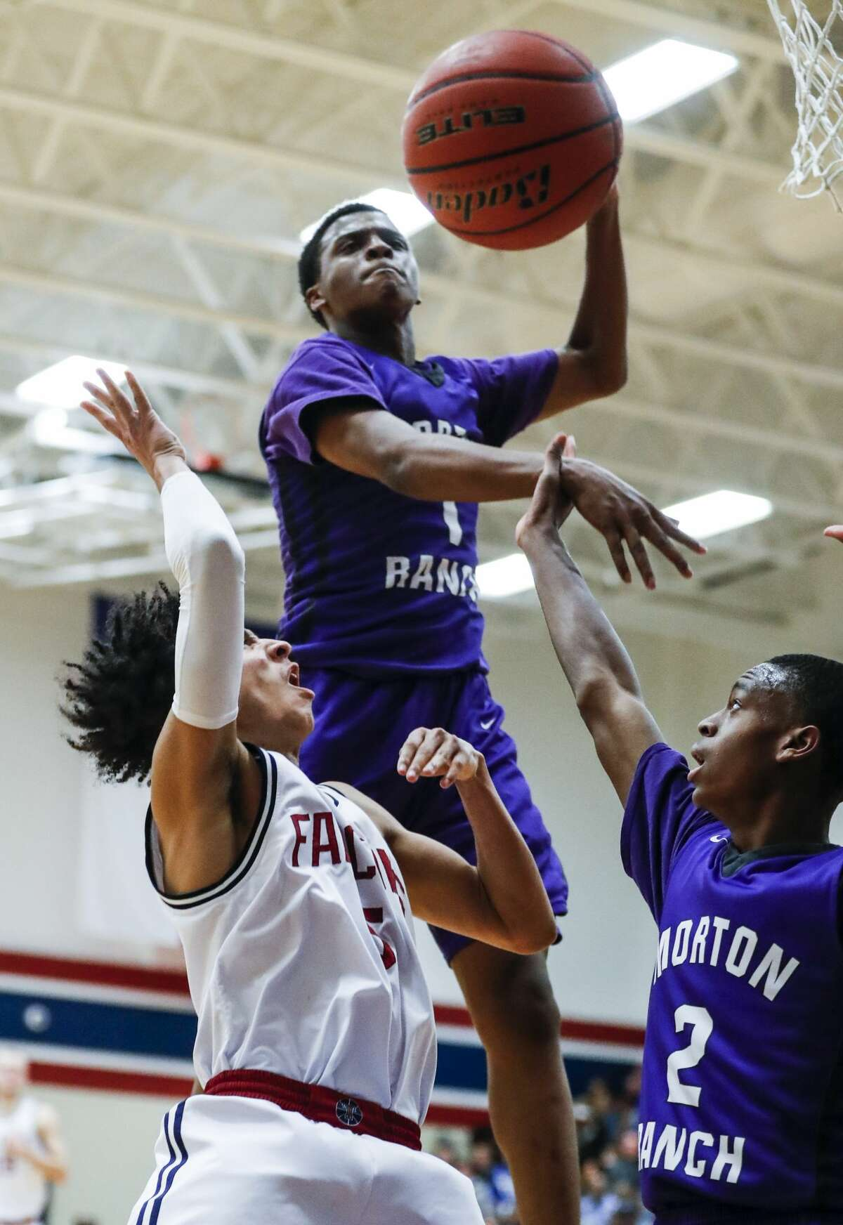 Morton Ranch's Marcellous Paul (1) blocks a shot by Tompkins' Emmanuel Holt (5) during a 19-6A high school basketball game at Tompkins High School on Friday, Jan. 19, 2018, in Katy. ( Brett Coomer / Houston Chronicle )