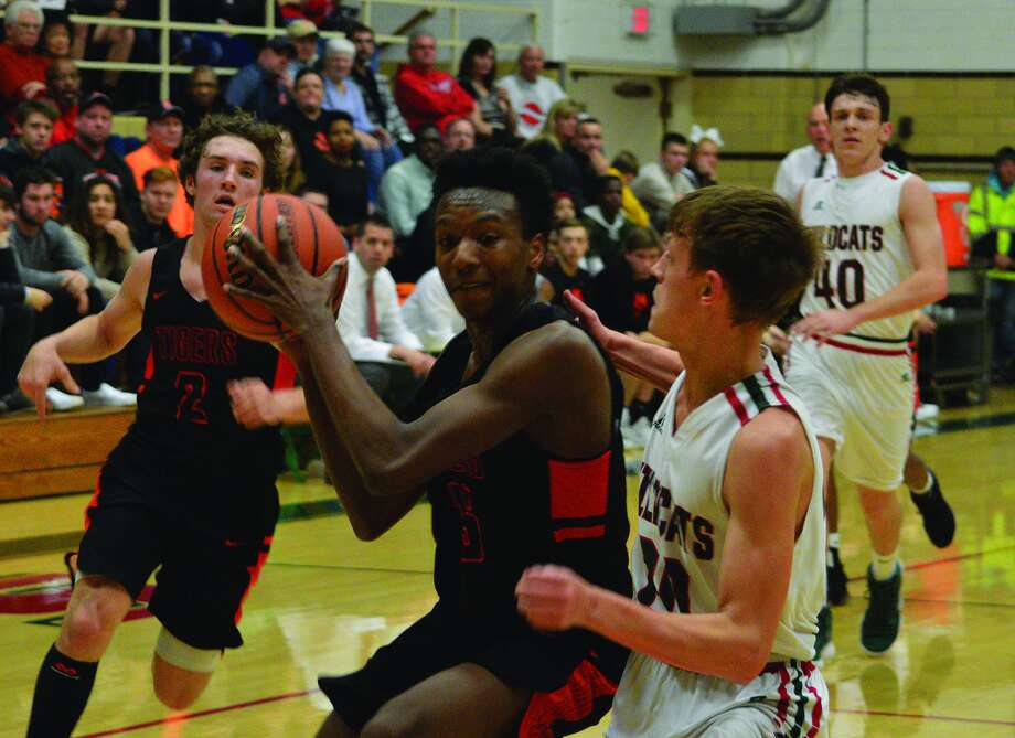 BOYS BASKETBALL Edwardsville runs wild in victory The