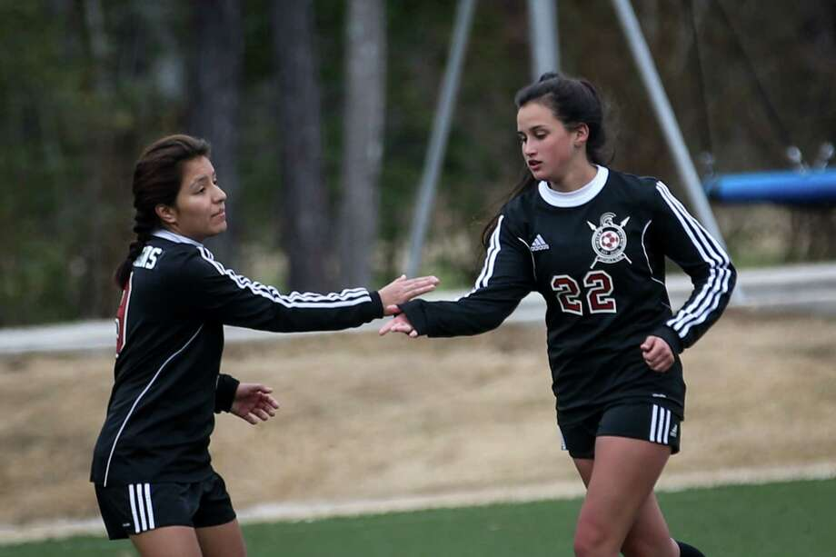 Porter's Kelly Rodriguez (22) slaps hands with Betty Hernandez (9) after scoring a goal during the Cavs and Cleats Classic girls soccer tournament against Conroe on Thursday, Jan. 18, 2018, at the Gosling Sports Complex in The Woodlands. (Michael Minasi / Houston Chronicle) Photo: Michael Minasi, Staff Photographer / © 2017 Houston Chronicle
