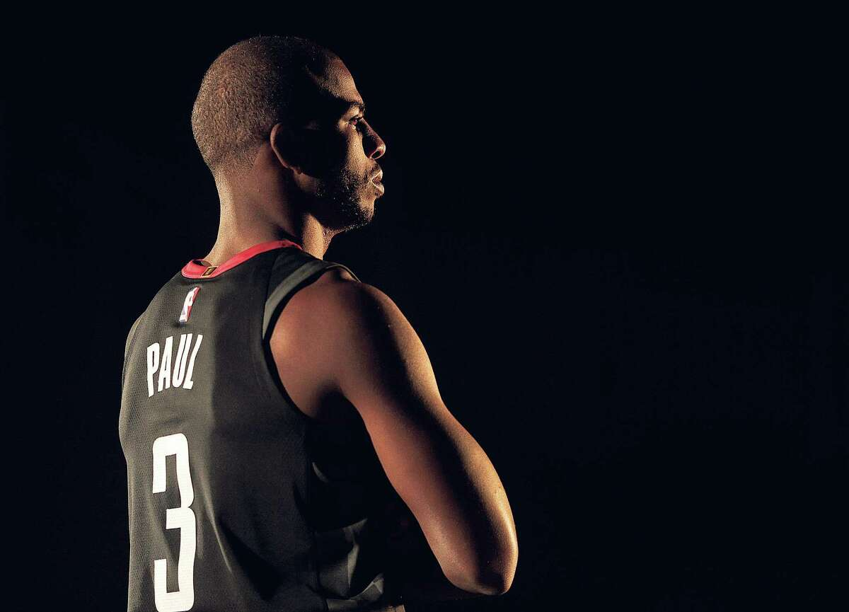 Rocket's Chris Paul (3) films a video during the Houston Rockets media day on Monday, Sept. 25, 2017, in Houston. ( Elizabeth Conley / Houston Chronicle )