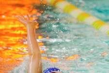 Midland's Tucker Pellegrino competes in the 100 yard backstroke during a meet against Saginaw Heritage on Friday at H. H. Dow High School. (Katy Kildee/kkildee@mdn.net)