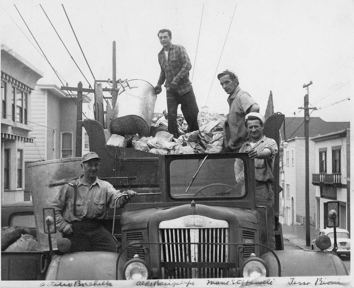 FILE-- Attilio Borghello (left), Aldo Bachigalupi, Mario Stefanelli and Terso Biconi collect trash in 1962, when trucks had four-man crews. Leonard Stefanelli, who rose from a garbage collector to president of San Francisco's largest refuse firm, died April 6 after a long illness. He was 83.
