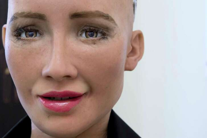David Hanson, the founder of Hanson Robotics, talks with his company's flagship robot Sophia, a lifelike robot powered by artificial intelligence in Hong Kong.