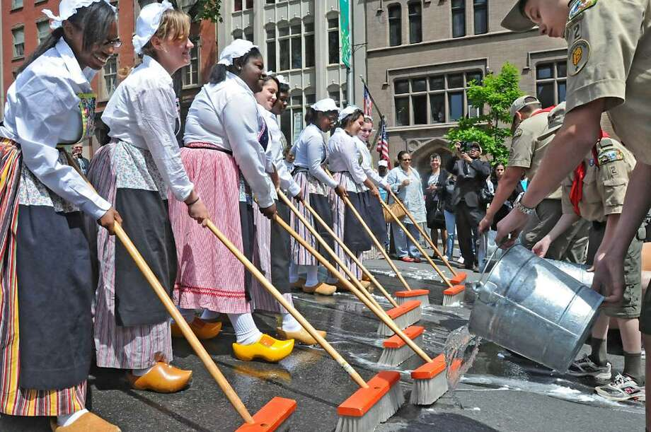 Albany High School seniors participate in the 62nd Annual Albany Tulip Festival street scrubbing ceremony on State Street in Albany on May 7, 2010. The sweepers are, from left, Kasiah Knight, Allie Diefendorf, Class President Sholanda Addison, Amanda Villela, Ayesha Holloway, Anazha Holt, Sabina Bektesevic and Catherine Gibbons. (Lori Van Buren / Times Union) Photo: LORI VAN BUREN