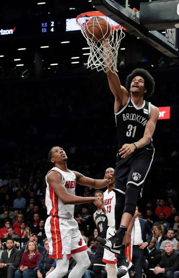 Brooklyn Nets' Jarrett Allen (31) dunks the ball in front of Miami Heat's Josh Richardson during the second half of an NBA basketball game Friday, Jan. 19, 2018, in New York. The Heat won 101-95. (AP Photo/Frank Franklin II) Photo: Frank Franklin II / Copyright 2018 The Associated Press. All rights reserved.