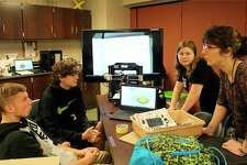 Laker science teacher Deb Hasselschwert talks with (from the left) Brent Krzeszewski, Jordan Yoder and Madison Hubert about their 3D printer in STEM class. (Submitted Photo)
