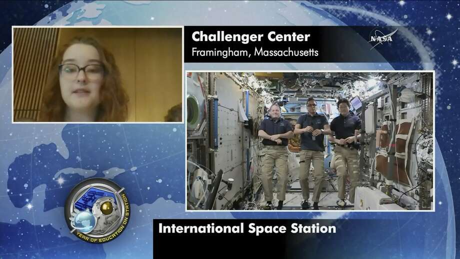 In this image made with video provided by NASA, astronauts Scott Tingle, Joe Acaba, Norishige Kanai, aboard the International Space Station, take questions from students at Framingham State University in Framingham, Mass., On Friday January 19, 2018. Thirty-two years after the Challenger disaster, the professors became Astronauts Ends and Ricky Arnold will pay homage to Christa McAuliffe by conducting science classes on the International Space Station. (NASA via AP) Photo: Associated Press