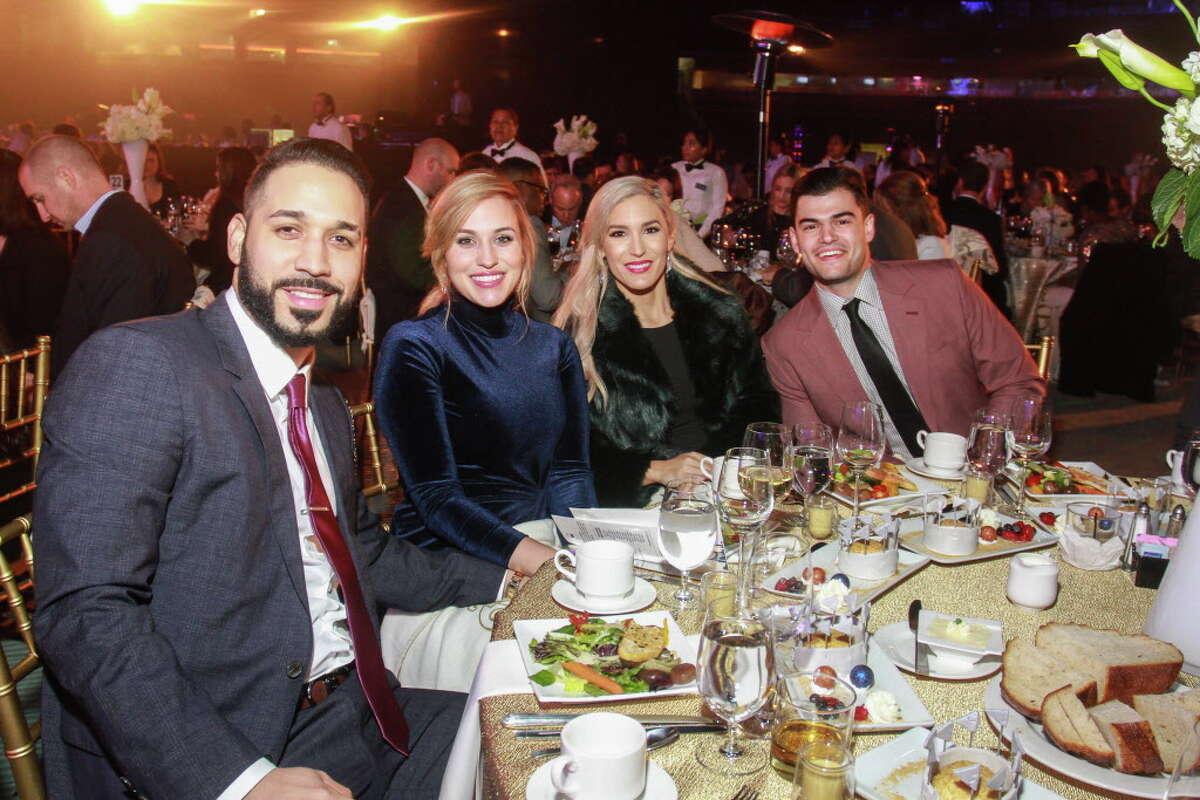 Marwin and Noel Gonzalez, from left, with Kara and Lance McCullers at the Astros Foundation annual Diamond Dreams Gala.