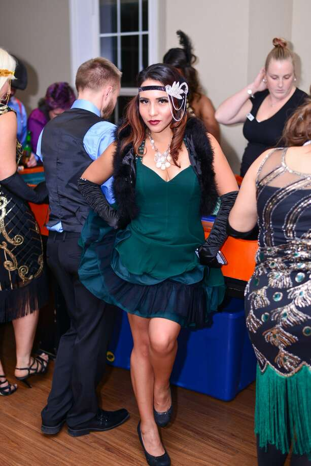 The Étonnant Fleur's Great Gatsby Roaring '20s party Friday night, Jan. 20, 2018, helped raise money to benefit area women veterans while flaunting a bit of ritzy style. Photo: Kody Melton For MySA