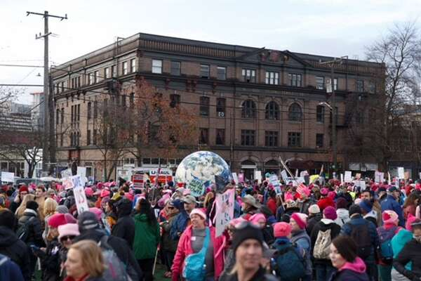 Demonstrators gather Saturday, Jan. 20, 2018, at Seattle's Cal Anderson Park in preparation for the second women's march.