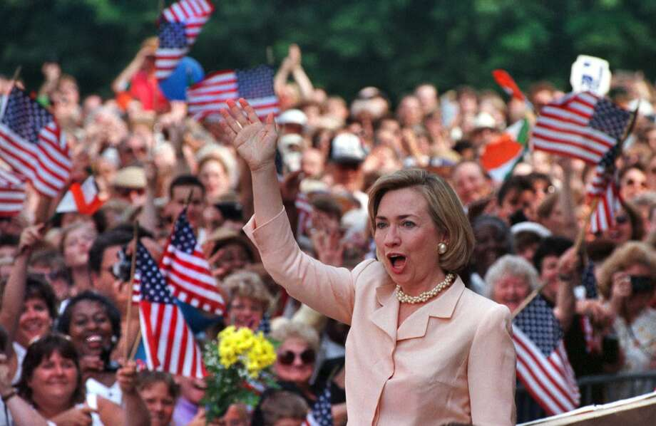 Times Union Staff Photo by Skip Dickstein--7/15/98--First Lady Hillary Clinton waves to a crowd of supporters before an address outside the Kate Mullany House in Troy, N.Y., Wednesday. Mrs. Clinton is on a tour through the mid-Atlantic and Northeastern regions hoping to encourage the continued partnership between the private sector and government to ensure that America's heritage is sustained for future generations Photo: SKIP DICKSTEIN / ALBANY TIMES UNION