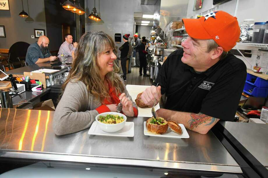 Melissa and Troy Boyce found love in a restaurant over cheese fondue. They are the owners of The Cheese Bar at the Boardwalk at Towne Lake, and recently celebrated National Cheese Lover's Day with the community. Photo: Tony Gaines/ HCN, Photographer