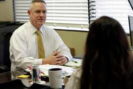 In this Tuesday, Dec. 19, 2017, photo, John Crossman meets with one of his employees at his office in Orlando, Fla. Crossman has had employees whose angry outbursts disrupted his commercial real estate company, and staffers whose personal problems made it hard for them get their work done. These are some of the hardest situations small business owners and managers can face. (AP Photo/John Raoux)