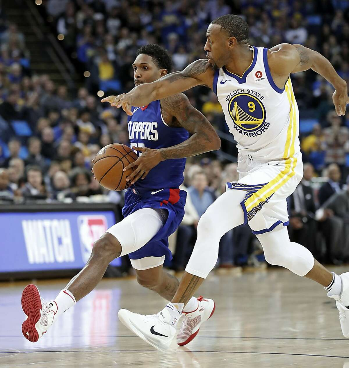 Golden State Warriors' Andre Iguodala can't slow down Los Angeles Clippers' Lou Williams during Clippers' 125-106 win in NBA game at Oracle Arena in Oakland, Calif., on Wednesday, January 10, 2018.