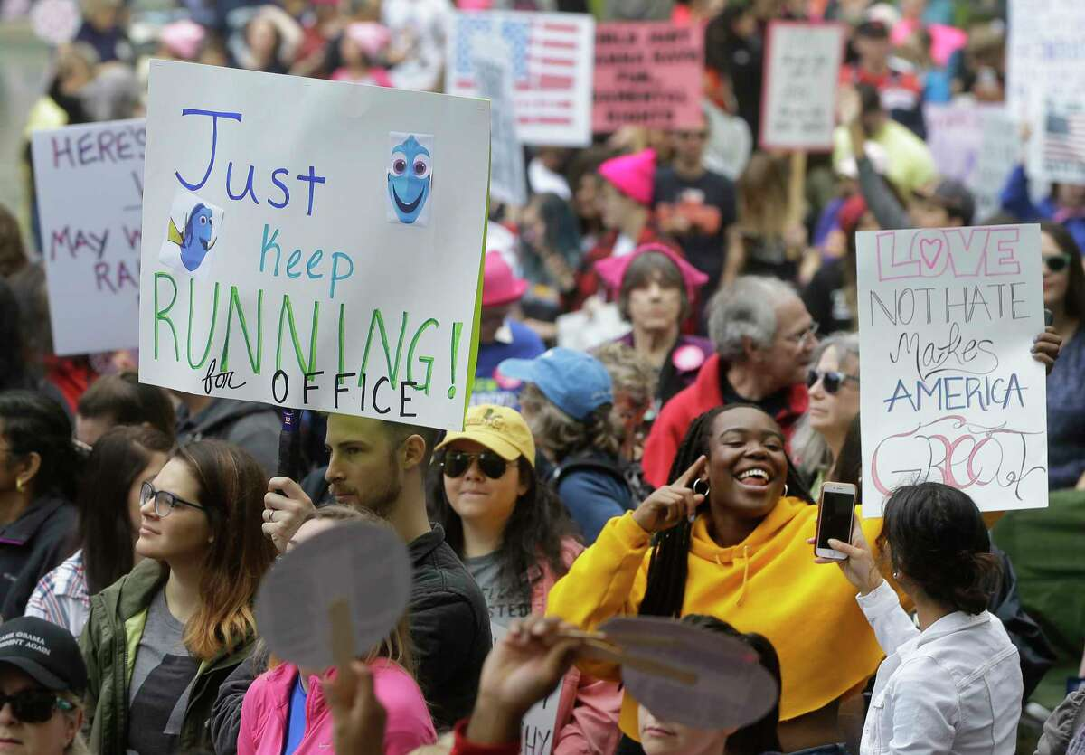 Signs from the Women's Marches taking places all over the world People rally at City Hall as part of the Houston Women's March Saturday, Jan. 20, 2018, in Houston.