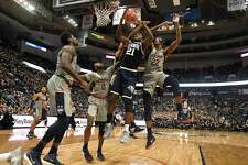 Villanova's Dhamir Cosby-Roundtree (21) is fouled from behind by Connecticut's Tyler Polley as Connecticut's Antwoine Anderson (0) and Terry Larrier (22) defend during the first half of an NCAA college basketball game, Saturday, Jan. 20, 2018, in Hartford, Conn.