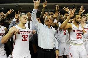 Houston head coach Kelvin Sampson, center, celebrates with his team Houston's 73-59 win over Wichita State in an NCAA college basketball game, Saturday, Jan. 20, 2018, in Houston. (AP Photo/Eric Christian Smith)