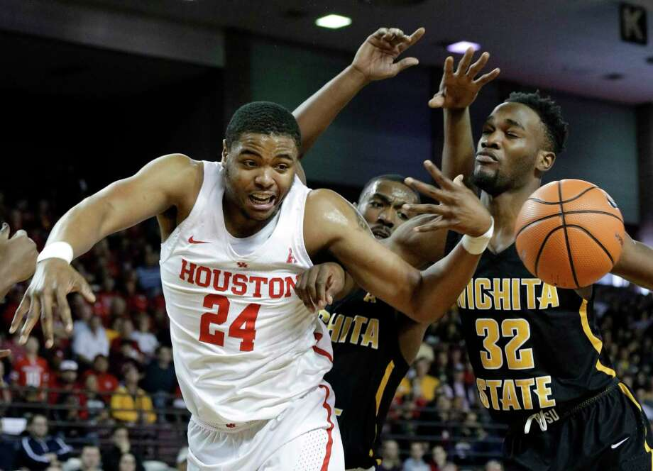 Houston forward Breaon Brady (24) loses a rebound under pressure from Wichita State forward Rashard Kelly (0) and forward Markis McDuffie (32) during the first half of their game at H&PE Arena at Texas State University Saturday, Jan. 20, 2018, in Houston, TX. (Michael Wyke / For the  Chronicle) Photo: Michael Wyke, For The Chronicle / © 2017 Houston Chronicle