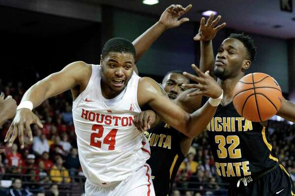 Houston forward Breaon Brady (24) loses a rebound under pressure from Wichita State forward Rashard Kelly (0) and forward Markis McDuffie (32) during the first half of their game at H&PE Arena at Texas State University Saturday, Jan. 20, 2018, in Houston, TX. (Michael Wyke / For the  Chronicle)