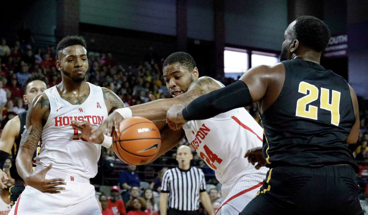 Houston forward Breaon Brady (24) gets the rebound from Wichita State center Shaquille Morris (24) as forward Devin Davis (15) looks on during the first half of their game at H&PE Arena at Texas State University Saturday, Jan. 20, 2018, in Houston, TX. (Michael Wyke / For the Chronicle)