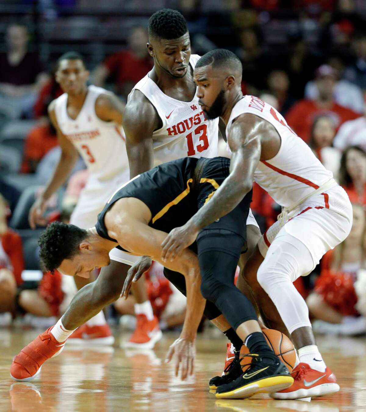 Wichita State guard Landry Shamet (11) loses the ball under pressure from Houston forward Nura Zanna (13) and guard Corey Davis Jr. (5) during the first half of their game at H&PE Arena at Texas State University Saturday, Jan. 20, 2018, in Houston, TX. (Michael Wyke / For the Chronicle)