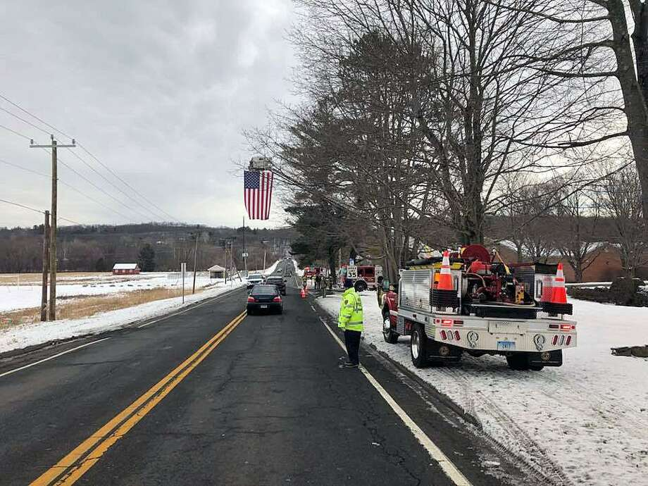 The Brookfield, Conn., Volunteer Fire Department put its flag on display for the funeral procession of longtime Brookfield resident Mark Modzelewski, officials said on Jan. 20, 2018. Photo: Contributed Photo / Brookfield Fire Department / Contributed Photo / Connecticut Post Contributed