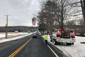 The Brookfield, Conn., Volunteer Fire Department put its flag on display for the funeral procession of longtime Brookfield resident Mark Modzelewski, officials said on Jan. 20, 2018.