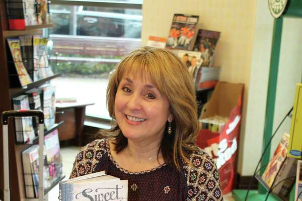 """Local author Linda Kozar signs her latest work,""""Sweet Tea For The Soul—Devotions to Comfort the Heart,"""" for fans during a book signing at Barnes & Noble."""